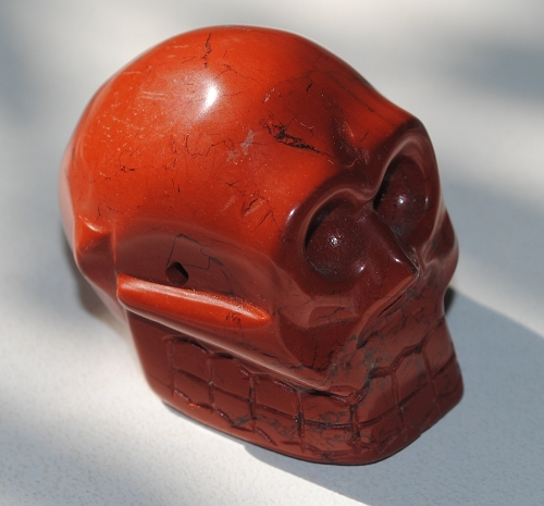 Cool looking red jasper skull carving with drilled side